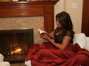 Reading by the Fireplace